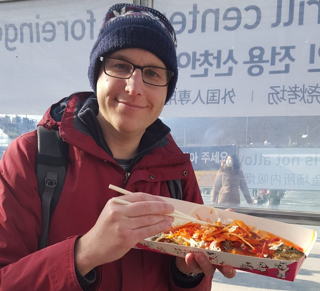 Eating freshly caught trout at the Hwacheon Ice Festival, South Korea