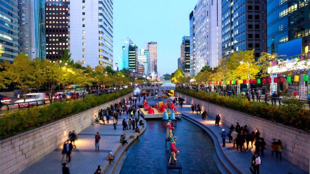 People enjoying the Chonggyecheon River in Seoul, South Korea