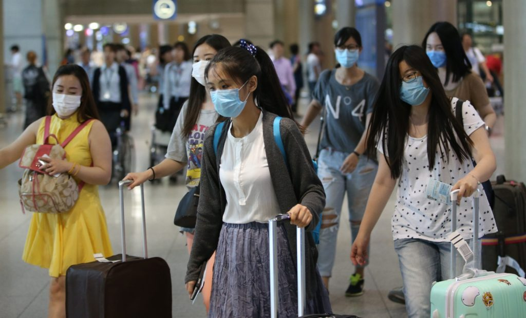 South Koreans wearing masks to protect against fine dust