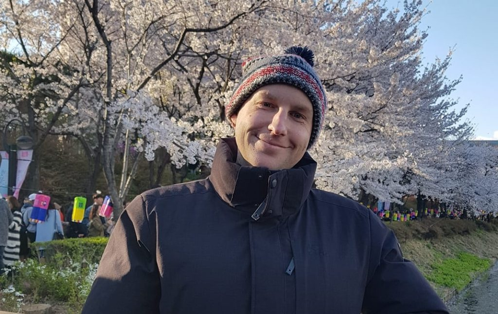 Joel with cherry blossoms at Seokcheon Lake, Seoul, South Korea