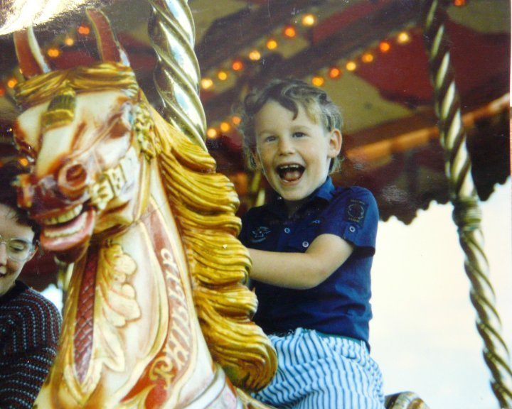Joel riding a fairground ride