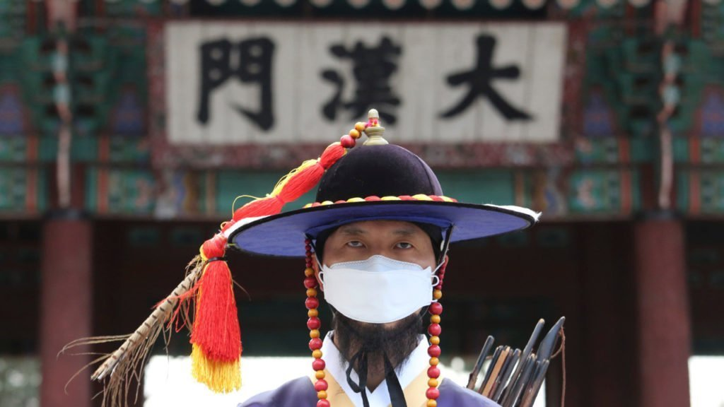 Palace guard in Seoul wearing a face mask