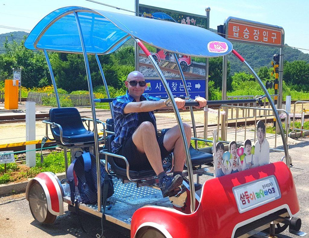 Joel Riding a rail bike in Korea