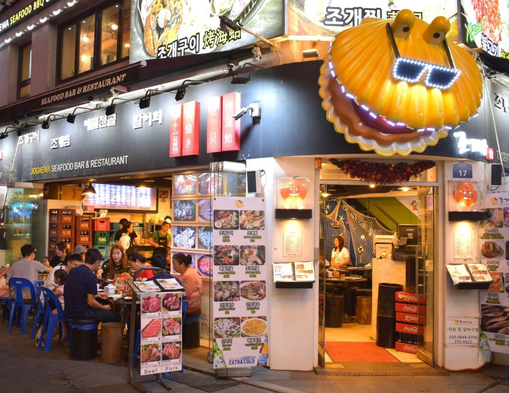 Use Korean phrases for ordering food in restaurants like this in Myeongdong, Seoul