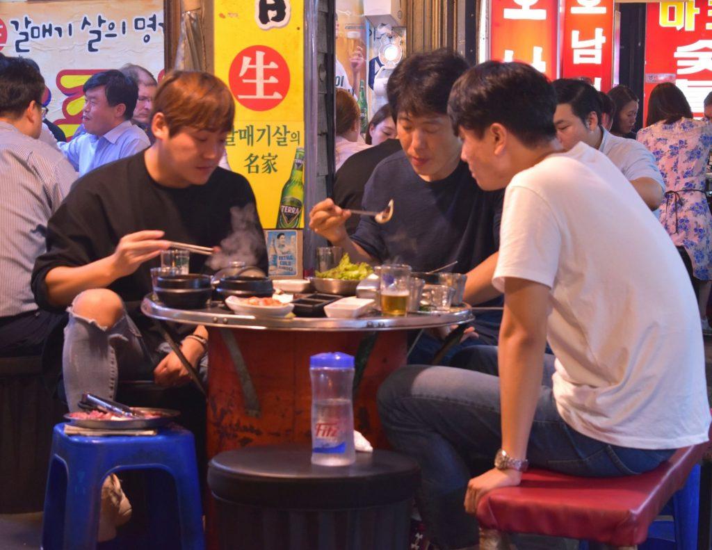 Korean people enjoying Korean BBQ in Seoul