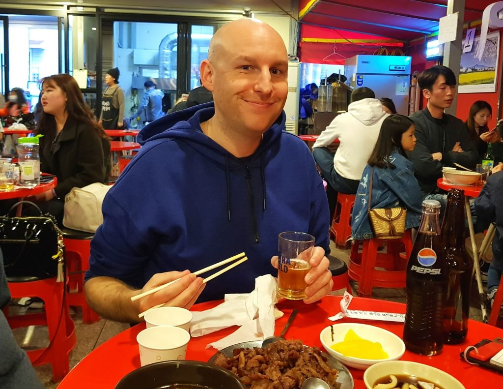 Joel using some Korean phrases for ordering food in Daegu