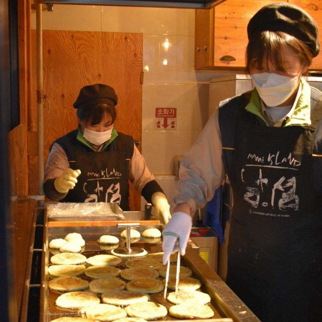 woman cooking hotteok Korean pancakes
